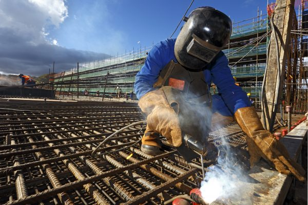 construction worker working by wearing welding gloves