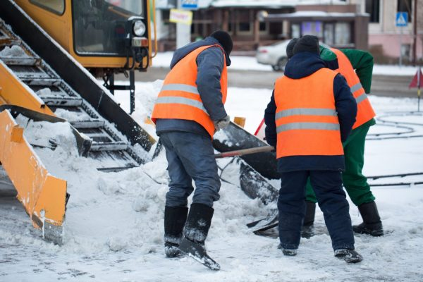 construction workers working on winter
