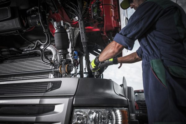 Mechanic working with wearing abrasion resistant gloves